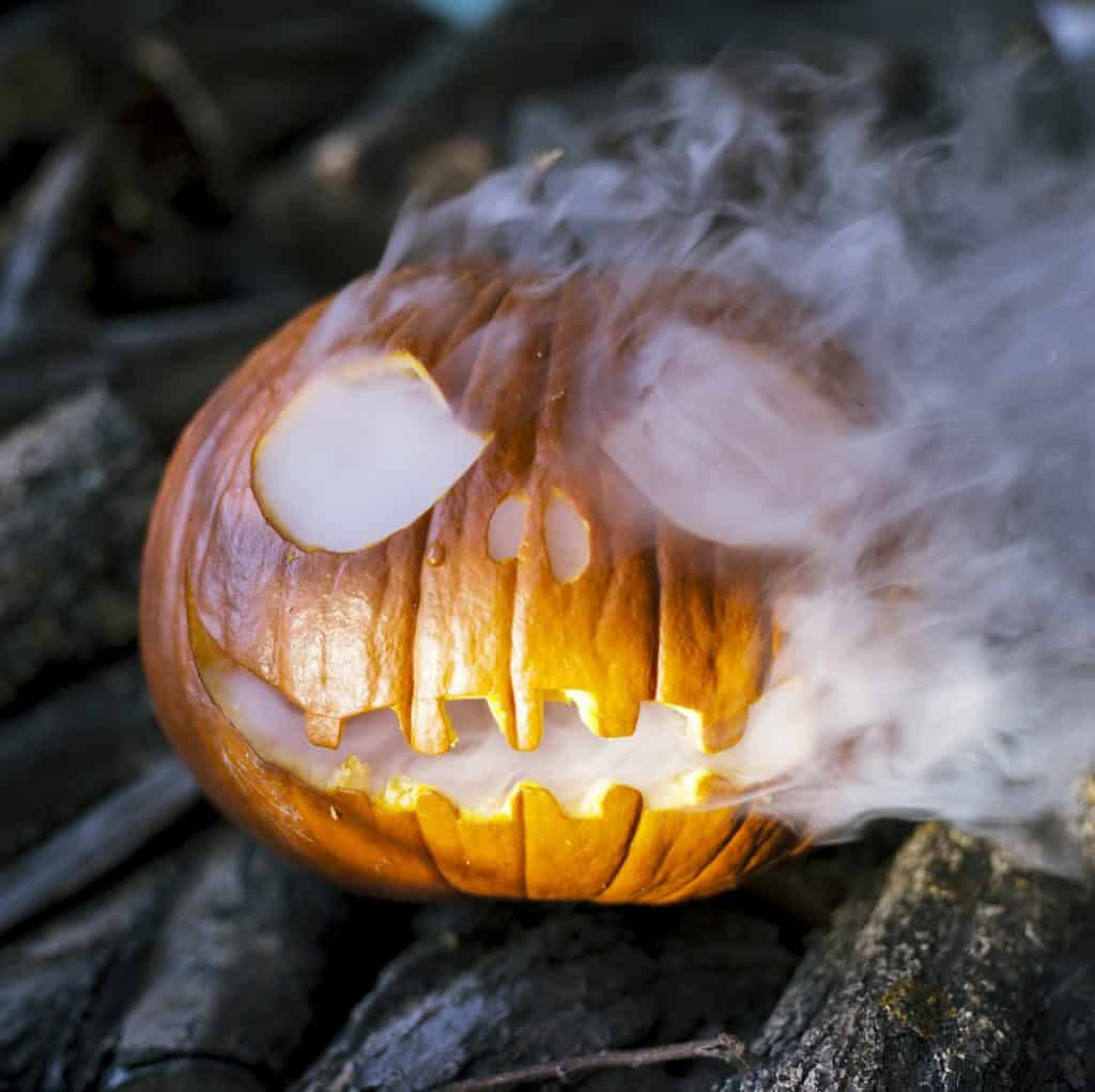 Carved Pumpkin filled with dry ice gives the perfect chill
