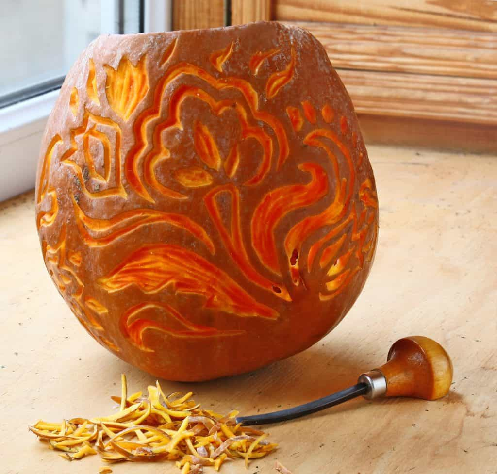 Carve a pumpkin with tools to get very detailed and beautiful designs