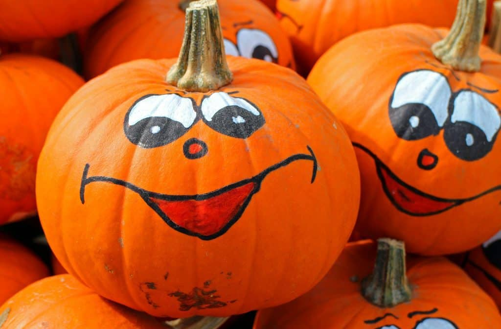 Pumpkin with eyes and mouth drawn on with marker.